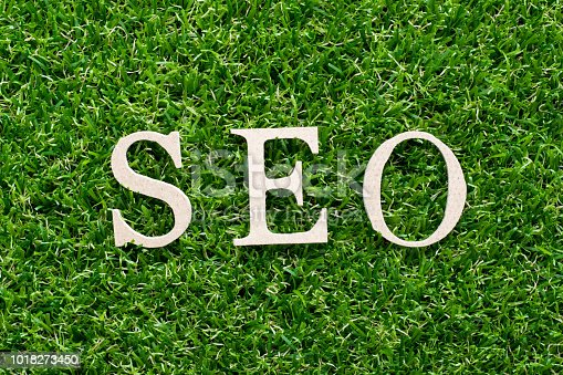 1045434476istockphoto Wood alphabet in word SEO (Abbreviation of search engine optimization) on artificial green grass background 1018273450