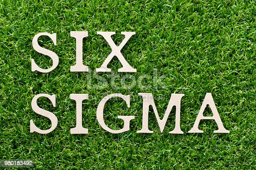 1180722244 istock photo Wood alphabet in word six sigma on artificial green grass background 980183492