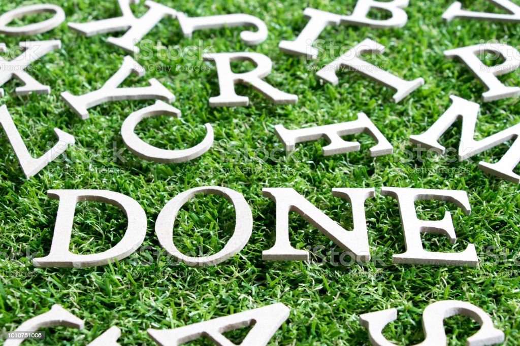 Wood alphabet in wording done  on artificial green grass background stock photo