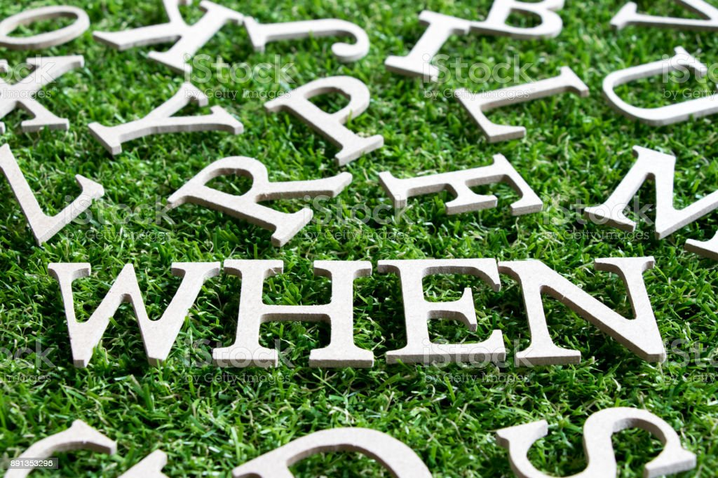 Wood alphabet in wording when on artificial green grass background stock photo