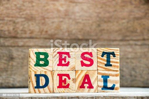istock Wood alphabet stack in wording best deal background 881649128