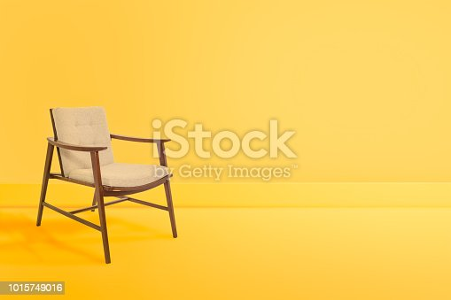 Wood and fabric chair in yellow color room for copy space. Empty room