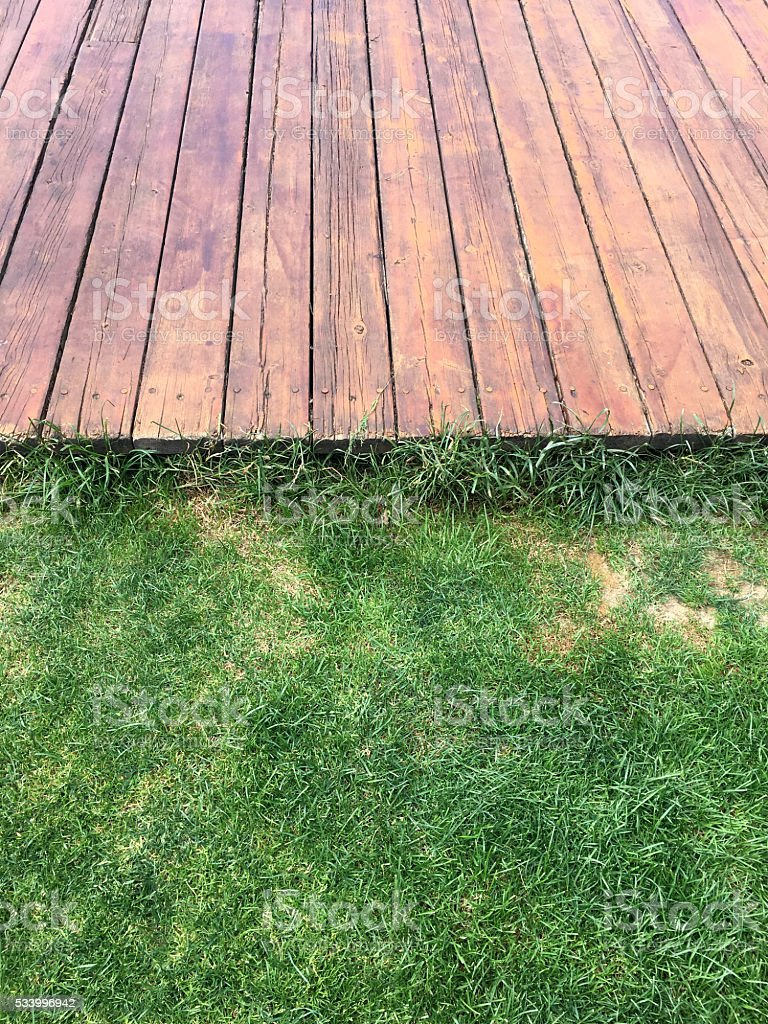 Wood and grass background texture stock photo