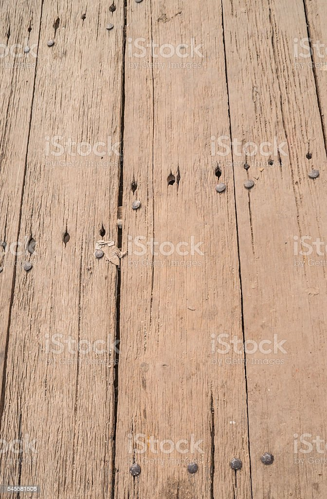 Wood background. Old sheathing planks. Boards with nails stock photo