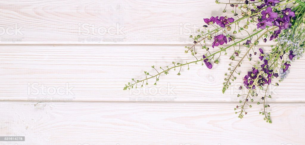 Wood background with bouquet of wild orchids stock photo