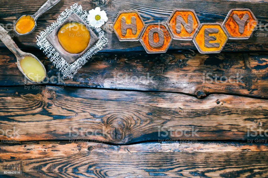 Wood background with honey title stock photo