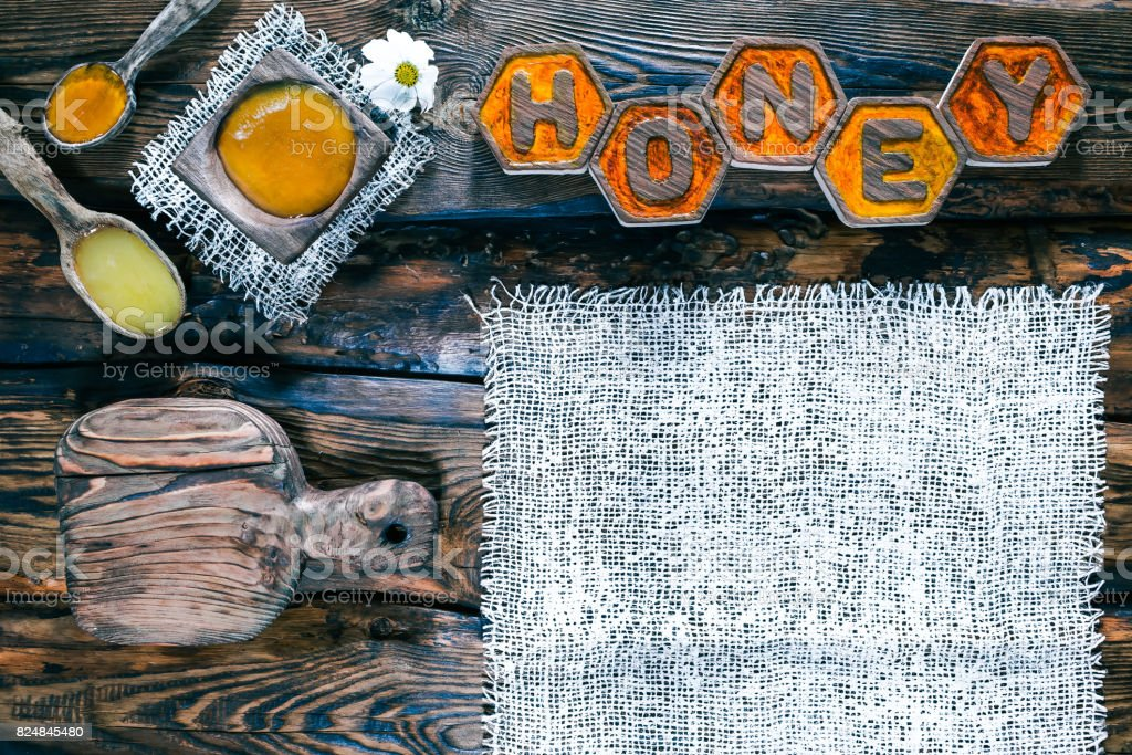 Wood background with honey title stock photo