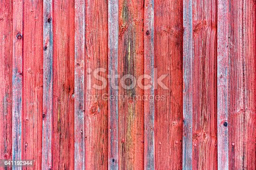 Wood Barn Wall With Red Peeling Flaking Color Red Wooden Background Texture Stock Photo & More Pictures of Abstract