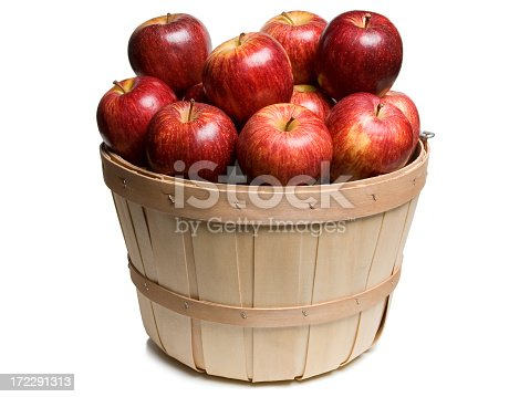 Wood basket with red apples on white background