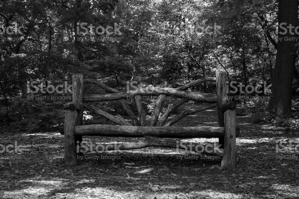 Wood bench at the park in black and white style royalty-free stock photo