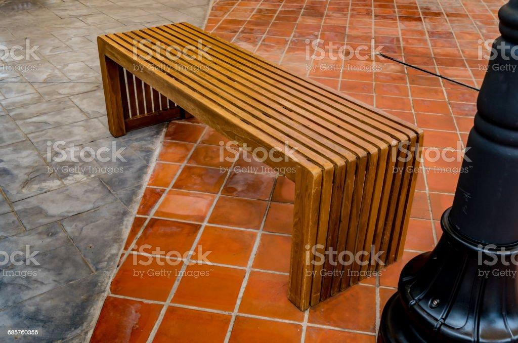 Wood bench on concrete floor zbiór zdjęć royalty-free