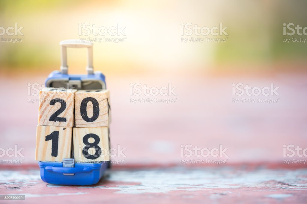 Wood block 2018 on miniature baggage using as background new year, vacation, and holiday concept stock photo