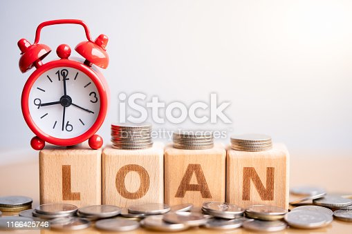 1024130248 istock photo Wood block 2020 on Coin stack. 1166425746