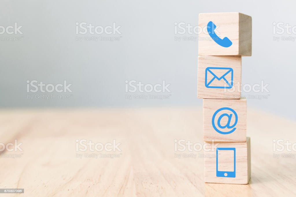 Wood block symbol telephone, mail, address and mobile phone, Website page contact us concept stock photo