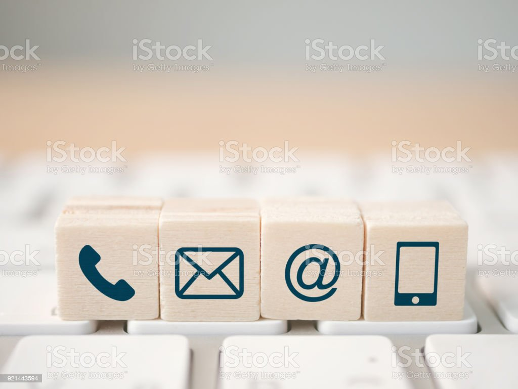 Wood block symbol telephone, mail, address and mobile phone. Website page contact us or e-mail marketing concept stock photo