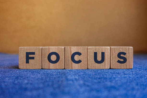 FOCUS, wood blocks on blue and brown background. stock photo
