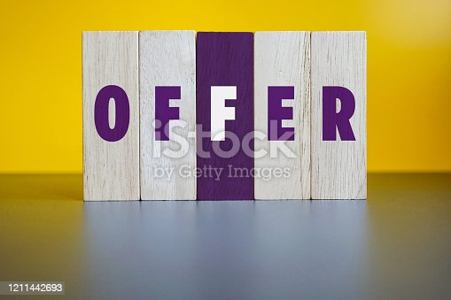 OFFER, Wood Blocks on Yellow Background.