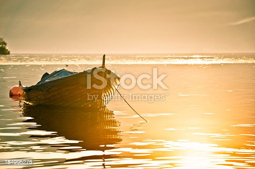 Wood boat in Lake Como at sunset.View my lightbox: