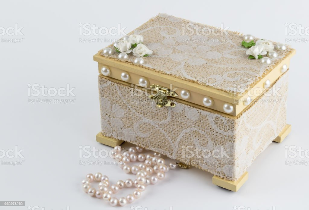 Wood box with pink pearl necklace on white stock photo