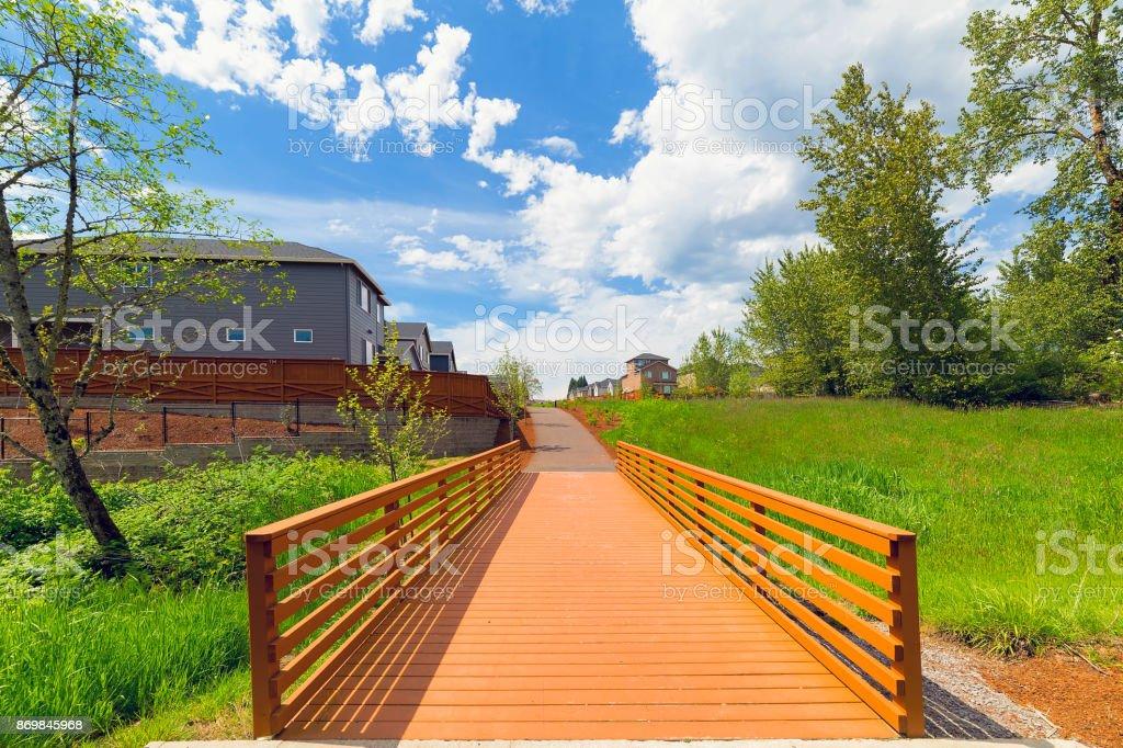 Wood Bridge along hiking trail in neighborhood park in Happy Valley Oregon USA stock photo