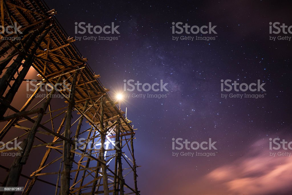 wood bridge decisive middle on milky way in sangkhaburi royalty-free stock photo