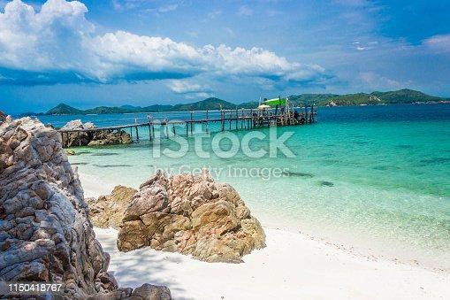 istock Wood bridge on the beach with water and blue sky. Koh kham pattaya thailand. 1150418767