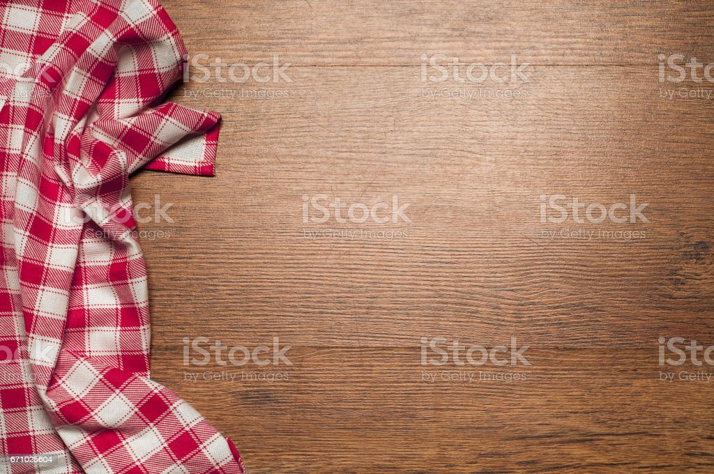 wood brown grain texture, dark wood wall background, top view of wooden table, red  textile, checkered napkin stock photo