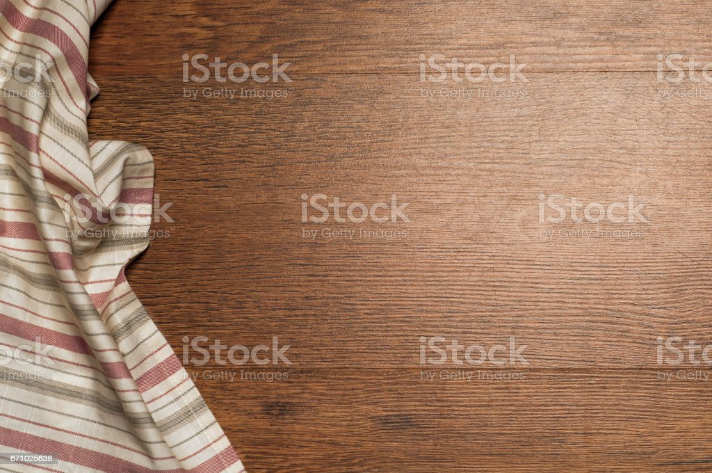 wood brown grain texture, dark wood wall background, top view of wooden table, green textile, napkin stock photo