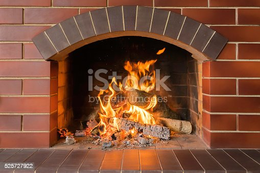 istock Wood burning fireplace in a bright fire 525727922