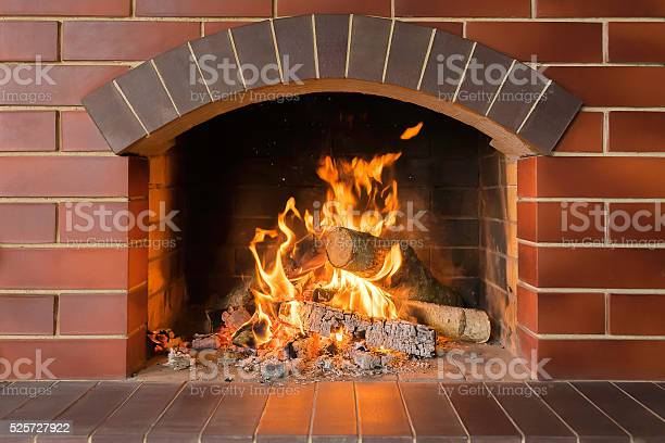 Photo of Wood burning fireplace in a bright fire