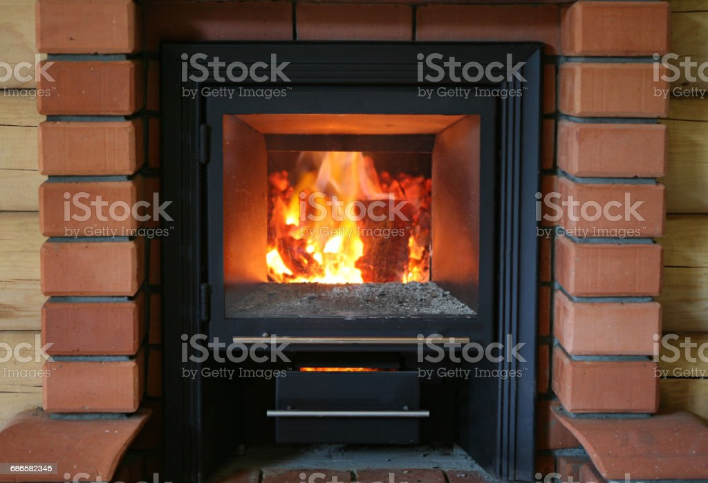 Wood burning in sauna oven. royalty-free stock photo