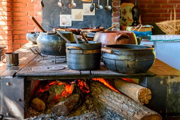 Wood burning stove and clay pots stock photo