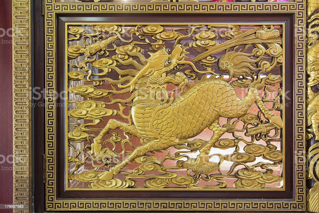 Wood Carved Qilin on Chinese Temple Wall royalty-free stock photo