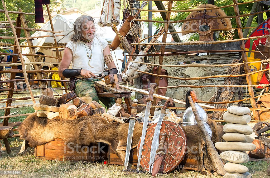 wood carver craftsman realize swords and shields during  Celtic Festival stock photo