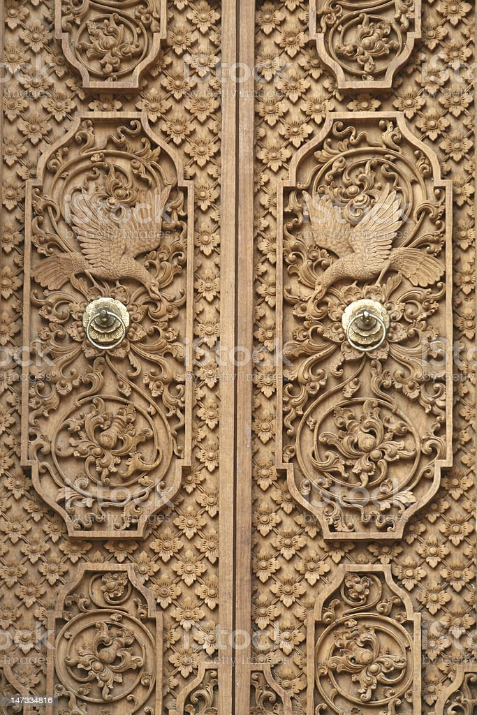 Wood Carving Door in bali royalty-free stock photo