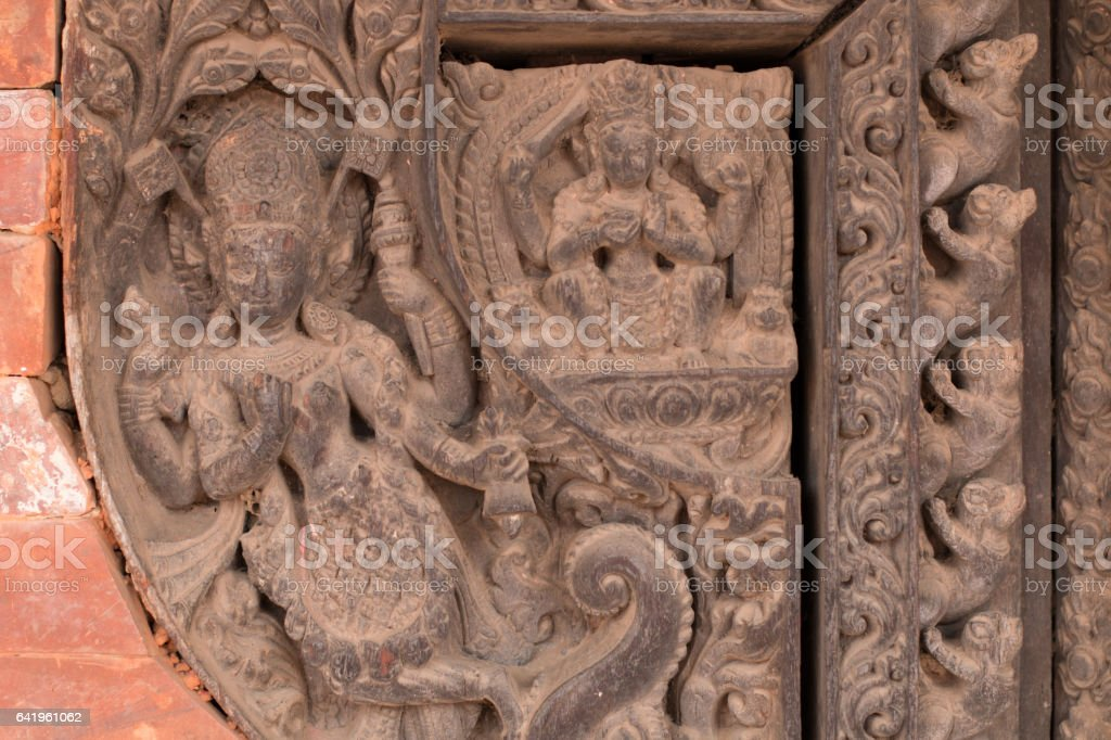 Wood carving of apsara in a building in Bhaktapur, Kathmandu stock photo