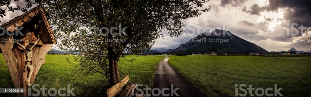 Wood Carving of Christ in the Alps stock photo