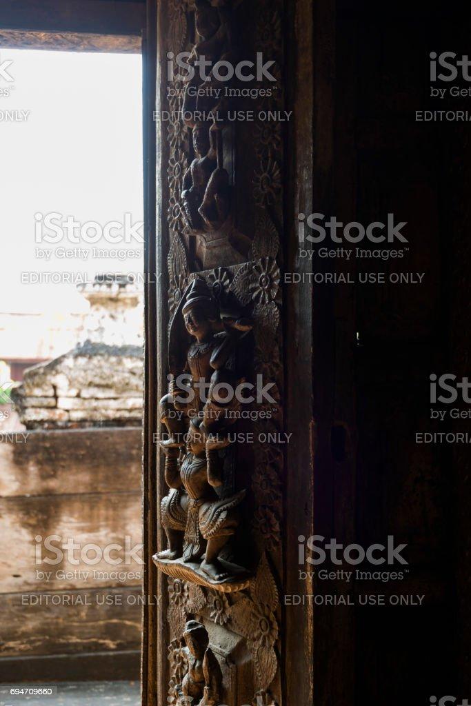 Wood carving of Shwenandaw Monastery depicting Buddhism Mythology, Mandalay, Myanmar stock photo