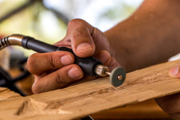 wood carving - dremel wood stock photos and pictures