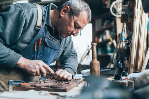Wood carving Senior carpenter working with tools carving craft product stock pictures, royalty-free photos & images