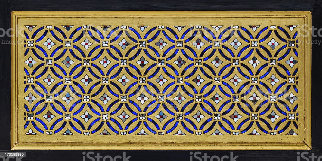 Wood Carving Traditional Thai Style in gold Color royalty-free stock photo