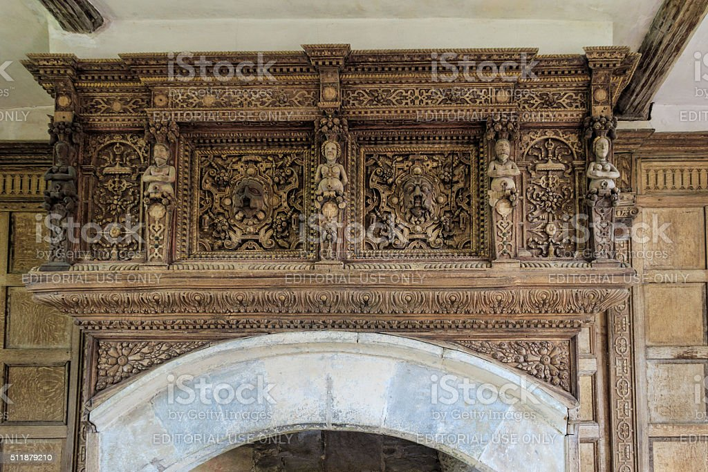 Wood carvings above a fireplace, Stokesay Castle. stock photo