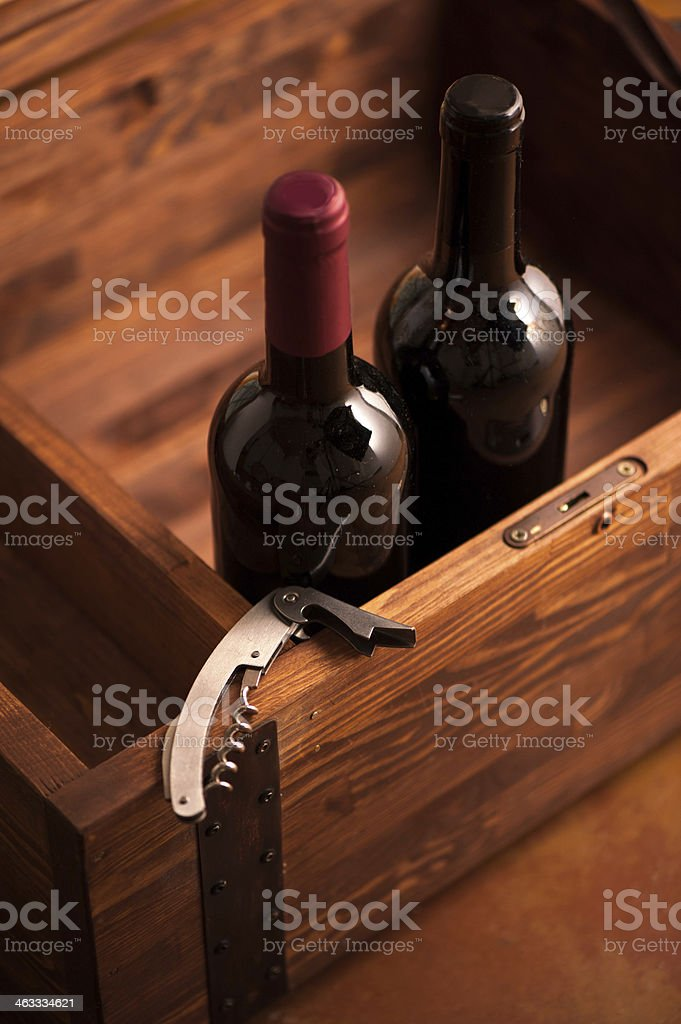 Wood case with bottles of wine stock photo