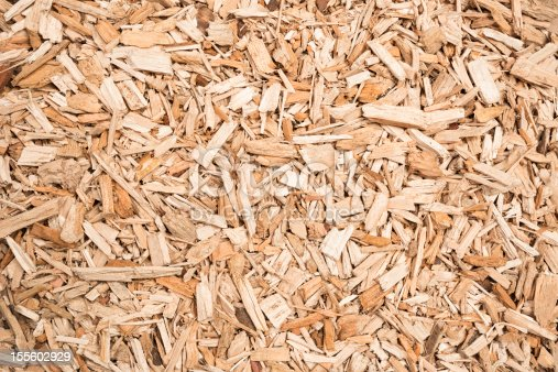 A background of wood chips, prepared as fuel for a biomass boiler.