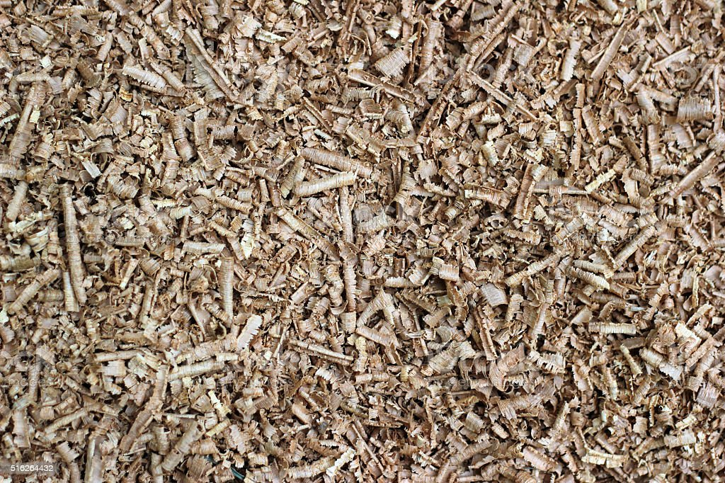 Wood chip shaving or shredded mulch material texture background stock photo