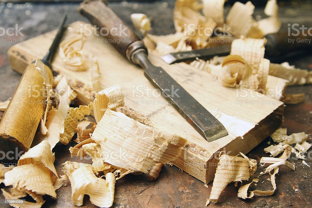 wood chisels with shavings on the workbench stock photo