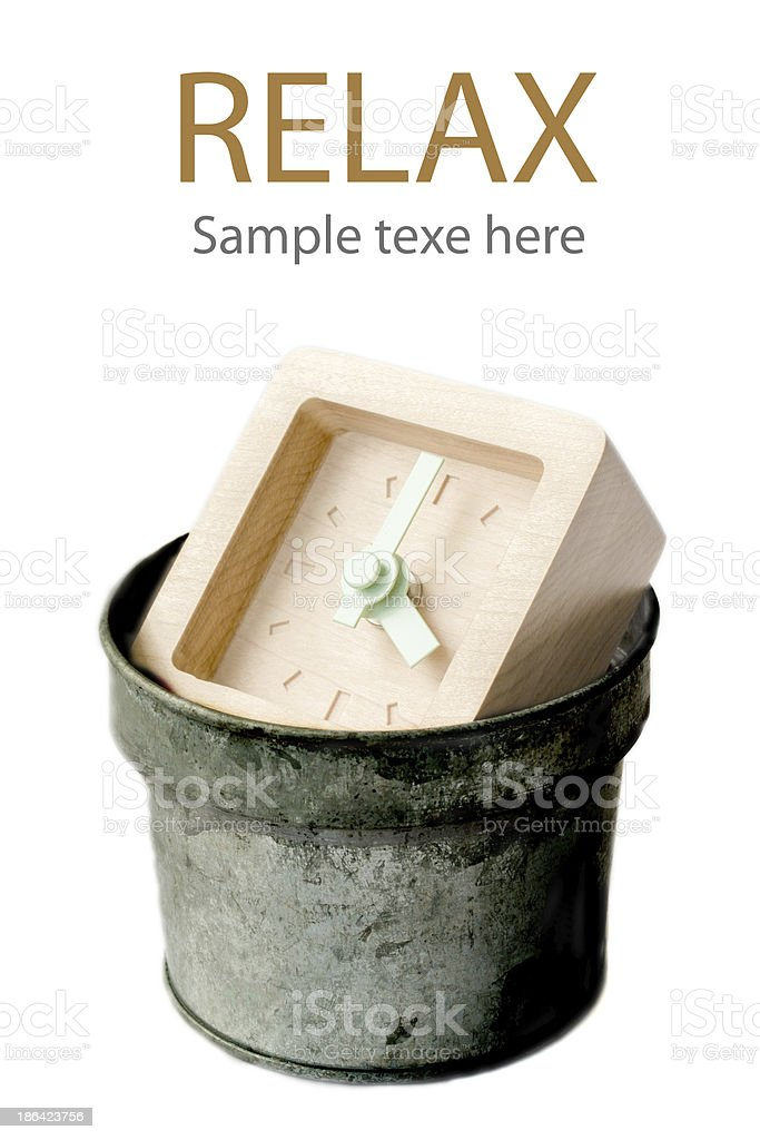 Wood Clock in metal trash bin. royalty-free stock photo