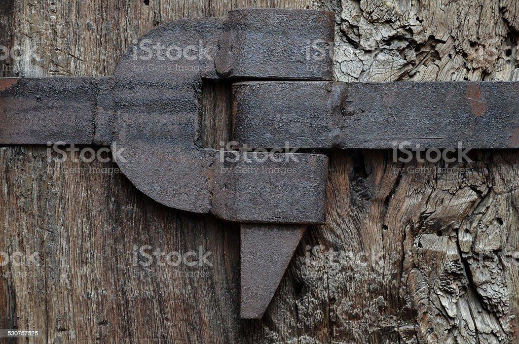 wood column with iron belt stock photo