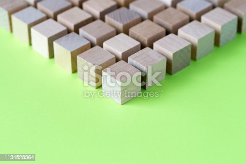 1134528355 istock photo Wood cubes arranged in pattern geometric 1134528364