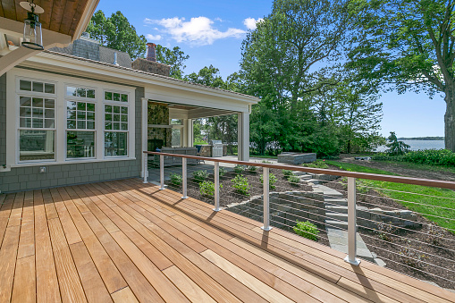 Lakeside luxury home with large wood deck and beautifully landscaped yard